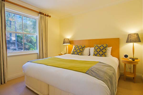 family friendly accommodation at Oaks Cypress Lakes resort in hunter valley bedroom with windows