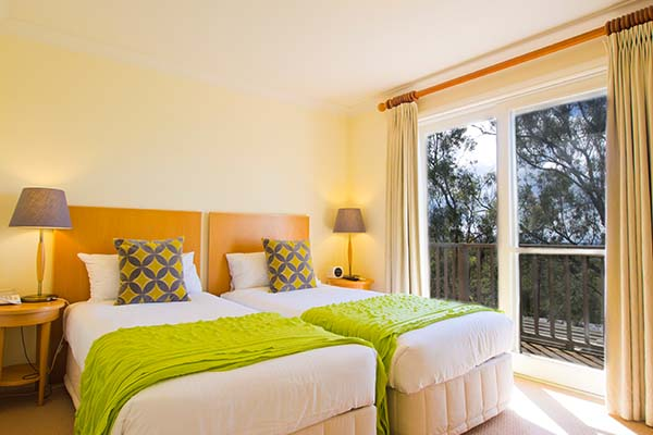 2 beds with sunshine coming through windows hunter valley resort