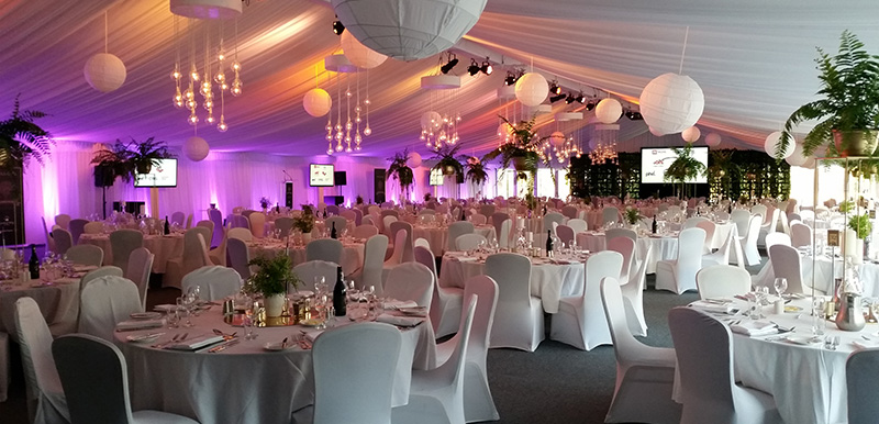 large function venue with microphone projector seating and speaker stand in hunter valley