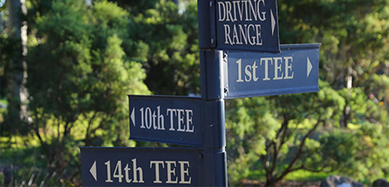 signs showing direction to hole at hunter valley golf course