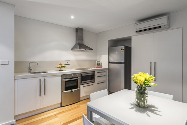 2 bedroom apartment kitchen at oaks lure hotel with wi-fi aircon fridge and stove top