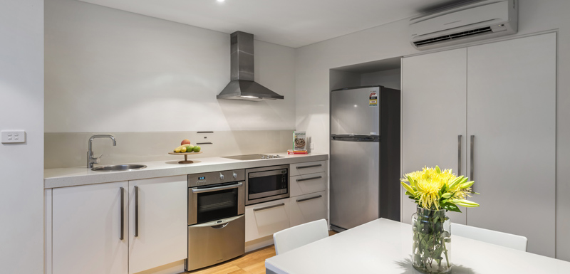 hotel kitchen with aircon wi-fi fridge oven and stove top at oaks lure hotel in port stephens