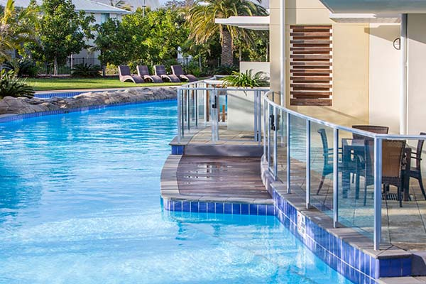 Port Stephens resorts with air conditioning and balcony extending over australias largest swimming pool at Oaks Pacific Blue resort hotel in NSW