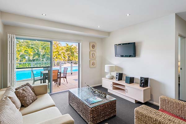 2 bedroom swimout hotel apartment accommodation with spacious lounge area television and stereo