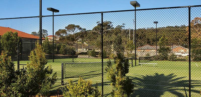 tennis court in sunshine at oaks pacific blue resort hotel port stephens