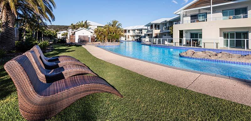 sun loungers along swimming pool at oaks pacific blue resort near newcastle