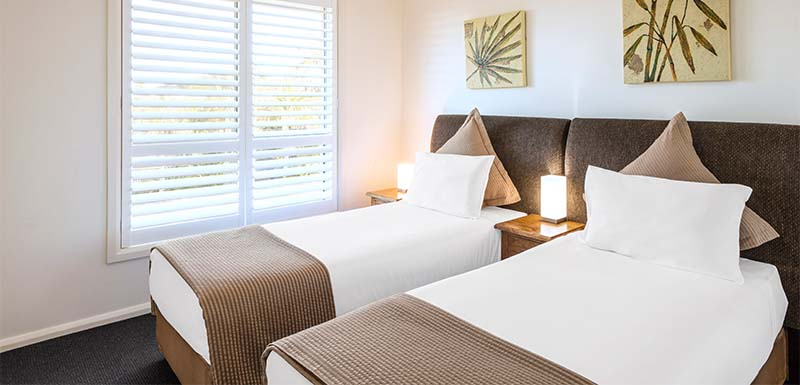 2 single beds in second bedroom at oaks pacific blue resort