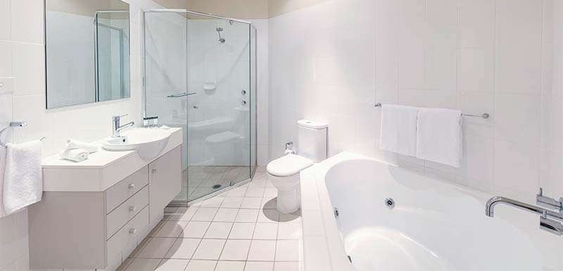 image of large hotel bathroom with bathtub shower and toilet in port stephens