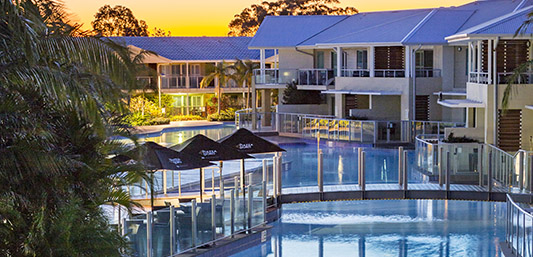 Oaks Pacific Blue Port Stephens Resorts pool at sunset in Port Stephens holiday apartments in New South Wales near Newcastle