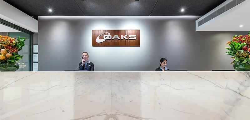 friendly staff at the reception of oaks goldsbrough darling harbour sydney hotel