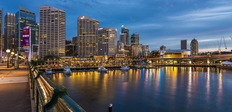 boats and yachts in Darling Harbour at sunset with Sydney city in background