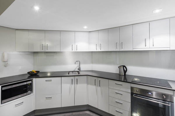 large modern kitchen area in 2 bedroom hotel apartment near Hyde Park in Sydney