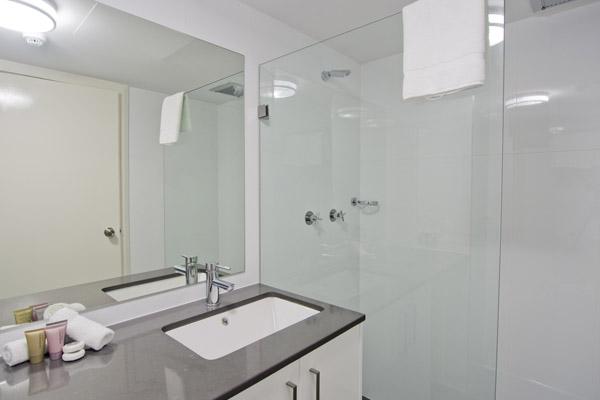 4 star hotel studio room with modern en suite bathroom, shower and toilet