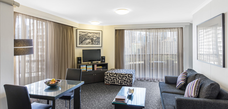 spacious, modern hotel living room at Oaks Hyde Park Plaza in Sydney