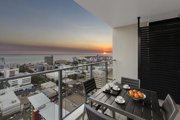 views of spectacular sunrise from balcony of Oaks Elan Darwin 1 bedroom apartment