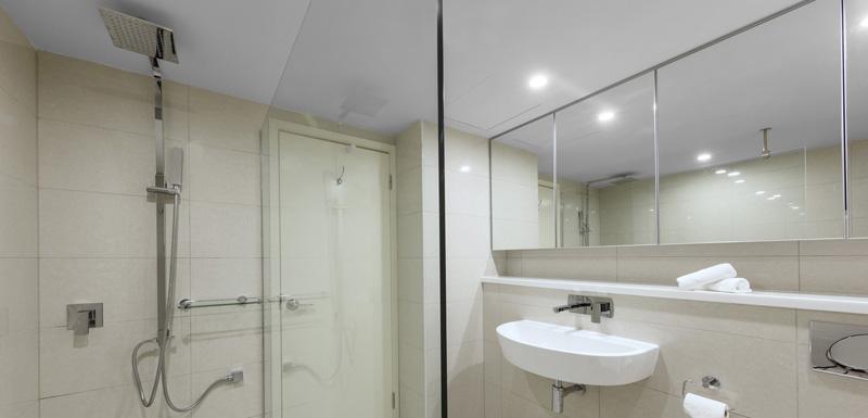 en suite bathroom with spacious shower in Darwin hotel 2 bedroom Harbour View apartment