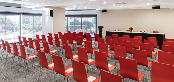 large conference room set-up for speaker with rows of chairs, sound system and microphone in Darwin NT