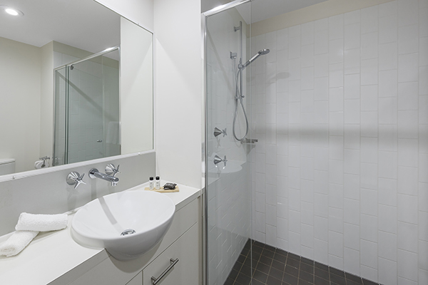 clean bathroom with walk-in shower at 2 Bedroom apartment of Oaks 212 Margaret brisbane hotel