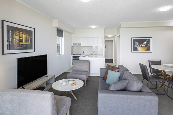 spacious and comfortable living room at 2 Bedroom apartment of Oaks 212 Margaret brisbane hotel
