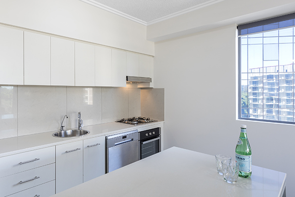 Fully equipped kitchen inside 2 Bedroom Hotel Apartment in Brisbane city centre