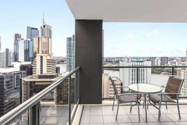 spacious balcony area with views of Brisbane city from 2 bedroom apartment at Oaks 212 Margaret street hotel in Brisbane CBD