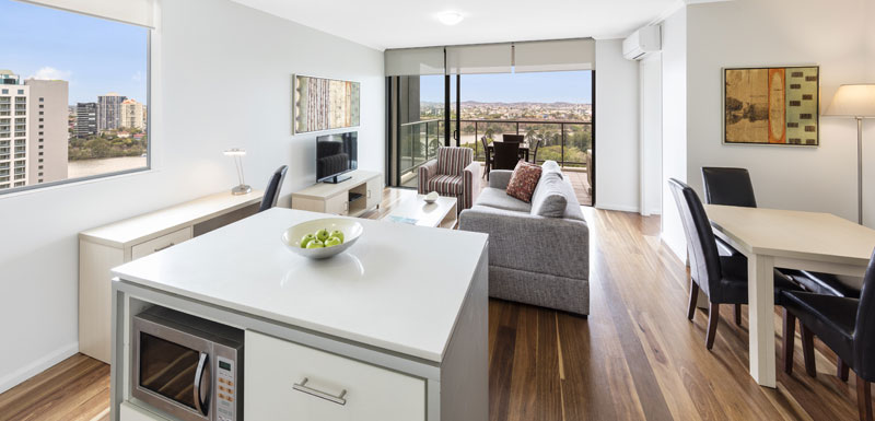 living room in 2 bedroom apartment in Brisbane city with air conditioner, television and views of Brisbane River