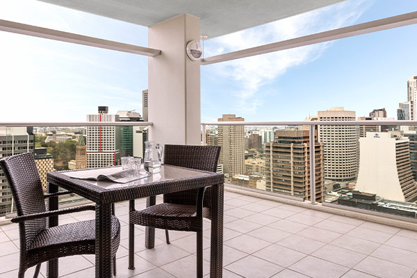 1 bedroom apartment balcony with table and chairs and view of Brisbane River at Oaks Casino Towers hotel