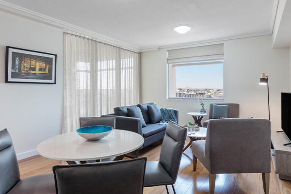 large living room area with comfortable couches with nice city view in 2 bed Brisbane hotel apartment