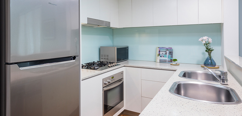fully equipped kitchen in Oaks Brisbane Casino Tower Suites 1 Bedroom Apartment Bedroom