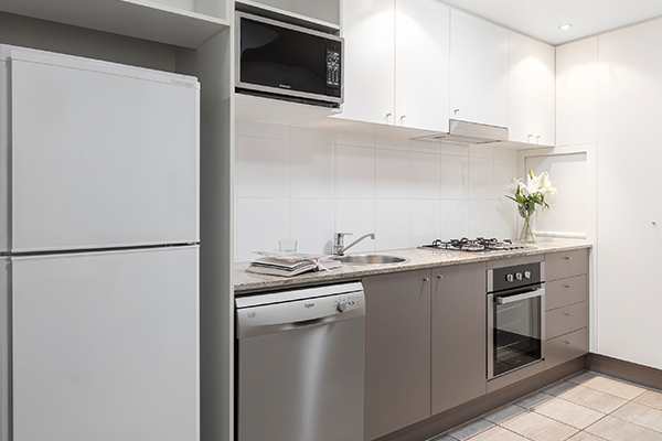 fully equipped kitchen at Oaks Brisbane on Felix Suites 1 Bedroom Executive
