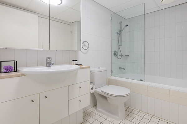 bathroom one with bathtub at Oaks Brisbane on Felix Suites 2 Bedroom Story Bridge View