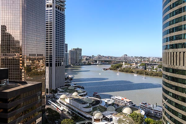 spectacular hotel room view of Story Bridge and CityCat on Brisbane River