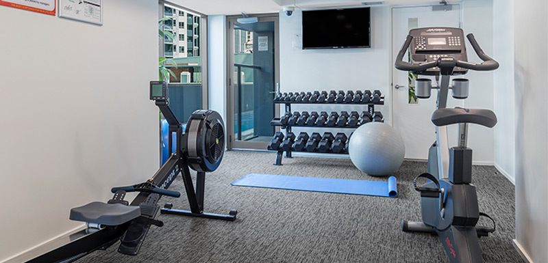 fully equipped gymnasium with rowing machine and treadmill at Oaks Felix hotel Brisbane city