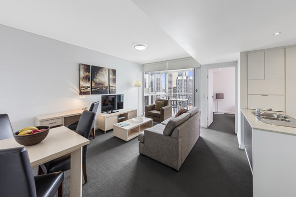 spacious hotel living room with comfortable furniture at Oaks Festival Towers hotel accommodation Brisbane CBD on Albert St near Queen Street Mall