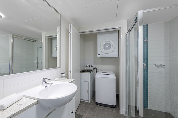 Bathroom and laundry inside 1 Bedroom hotel apartment Brisbane city