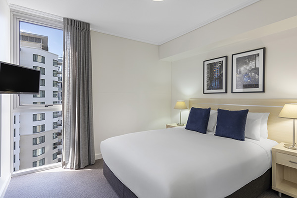 Comfortable bed inside 1 bedroom hotel apartment with Foxtel in Brisbane city
