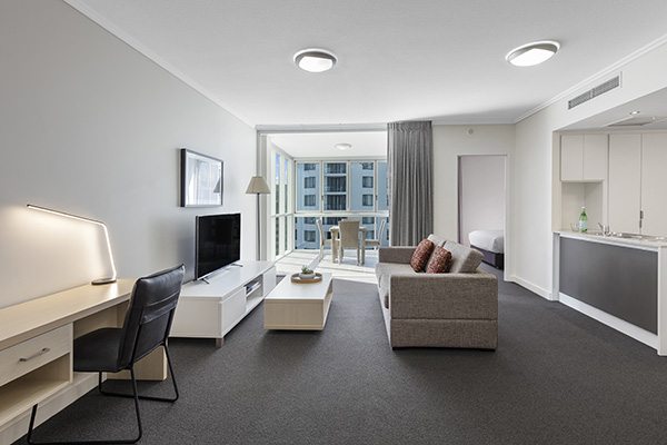 Spacious lounge room inside 1 bedroom hotel apartment Brisbane CBD