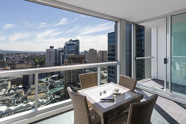Small balcony overlooking Brisbane city in 2 bedroom hotel apartment Brisbane CBD