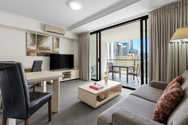 iStay River City one bedroom living connected to a spacious balcony