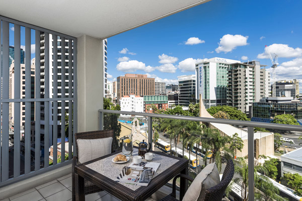 Brisbane CBD Hotels balcony with table, chairs and views of Brisbane city from Oaks Lexicon Apartments 1 bedroom apartment
