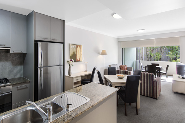 living room area with comfortable furniture in 1 bedroom apartment at Oaks Mews hotel near Royal Brisbane Womens Hospital