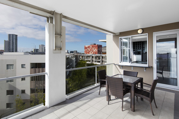 Bowen Hills Hotels large 3 bedroom apartment balcony with tables and chairs on Campbell Street in Bowen Hills Brisbane