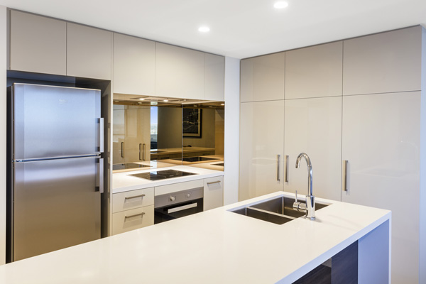 kitchen with microwave, big fridge and oven in 2 bedroom apartment at The Milton Brisbane hotel