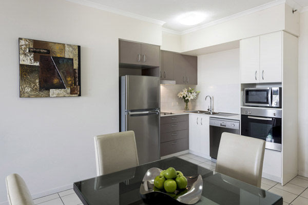 open plan kitchen with microwave and large fridge at Oaks Aspire hotel in Ipswich, Queensland
