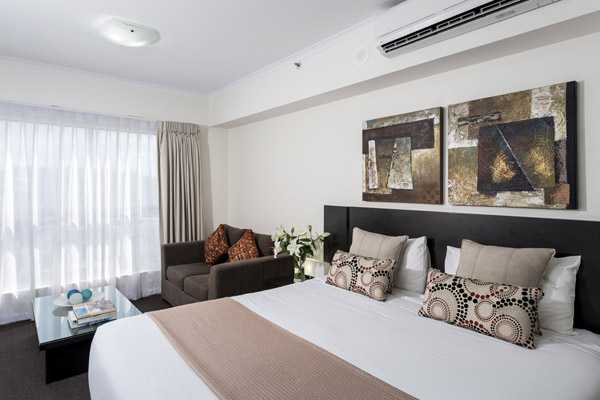 Hotels In Ipswich with queen size bed in studio apartment at Oaks Aspire hotel in Ipswich, Queensland, Australia