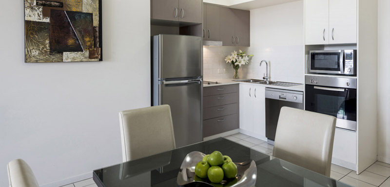 kitchen with dishwasher, fridge and microwave in 1 bedroom apartment at Oaks Aspire hotel Ipswich, Queensland