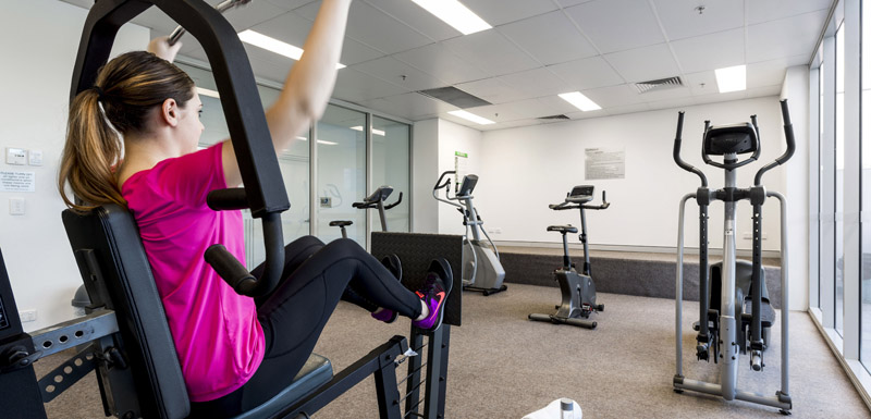 corporate traveller using fully equipped gym at Oaks Aspire hotel while on business trip to Ipswich, Queensland