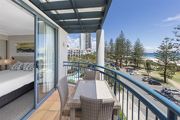 view of park and ocean from one bedroom ocean premier apartment at Oaks Calypso Plaza resort in Gold Coast, Australia