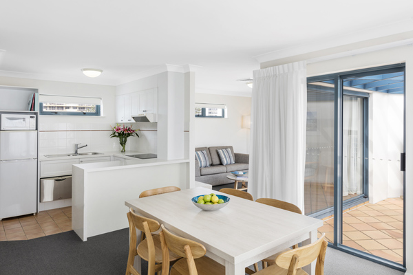 air conditioned two bedroom apartment with open plan living room leading to balcony with ocean views on Gold Coast, Australia