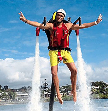 man using water jetpack ride on gold coast